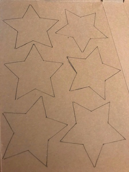 Recycled Paper Memorial Day Wreath - stars traced on cardboard