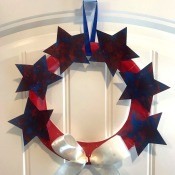 Recycled Paper Memorial Day Wreath - finished wreath hanging on over the door hook