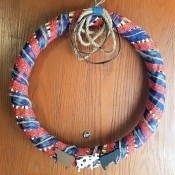 Spring Calving Season Cowboy/Cowgirl Wreath - finished wreath hanging from an over the door hook