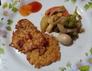 Noodle Pancakes on plate with veggies