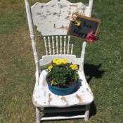 Garden Flowerpot Chair Planter - finished planter with yellow flowers and the bee garden sign