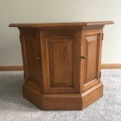 Value of a Conant Ball Octagon Table - medium finish table with door