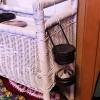 A Dollar Store lantern hung near a bed.