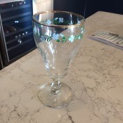 Identifying Vintage Drinking Glasses - gold rim trimmed, stemmed glass with blue floral and leaf pattern around the top