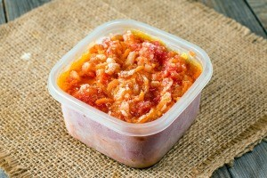 A container of frozen tomato sauce.