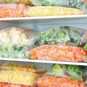 Bags of vegetables in the freezer.