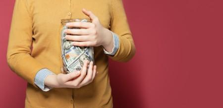 A jar full of dollar bills.