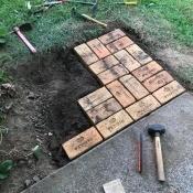 Adding bricks to the patio.