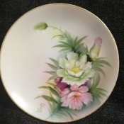 Value of Noritake Dinner Plates - white plate with gold trim and floral and leaf spray with arching bud