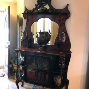 Identifying a Mirrored Hutch - perhaps antique hutch, with mirrored top, glass door on lower half, several shelves and quite ornate