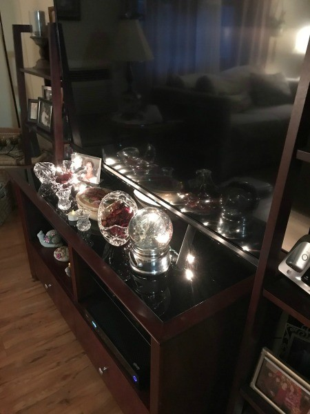 Decorative lighted ornaments on an entertainment center.