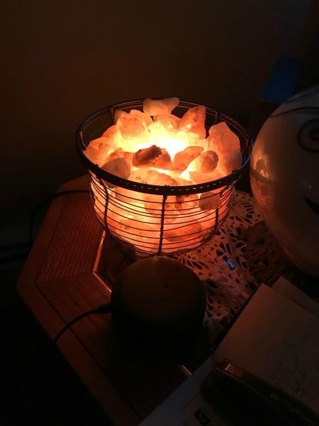 A decorative light in a darkened room.