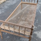 Identifying a Vintage Wooden Bed Frame with Mesh Springs - old bed frame sitting in a driveway