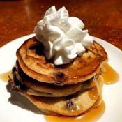 stack of Chocolate Chunk Pancakes with whipped cream