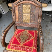 Value of an Ornate Wooden Chair - ornate wooden chair with embossed metal inserts and buttons
