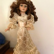 Value of a Collector's Choice Series Doll by DanDee - doll with long dark curls wearing an embroidered ecru dress