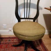 Identifying a Vintage Chair - round rather low seated chair with a almost harp shaped wooden back