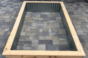 Galvanized Roofing Raised Bed - finished raised bed assembly on patio