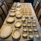 Age of Noritake Goldmount Set - china laid out on dining table