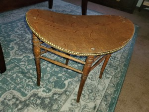 Identifying a Saddle Shaped Chair -  oval stool/chair row of brass studs around the edge