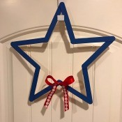 Minimal Star Craft Stick Wreath - closeup of star wreath with the red and white bow