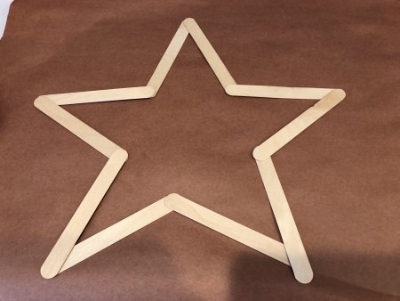 Minimal Star Craft Stick Wreath - laying out the craft sticks in a star shape