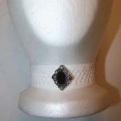 Four Necklaces for a Dollar - foam head with a white headwrap necklace with a vintage style button in the center