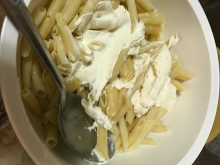 cheese added to pasta