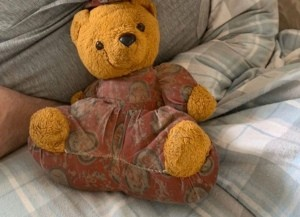 Identifying a Stuffed Toy - overstuffed print fabric body with bear head, hands, and feet sewn in place