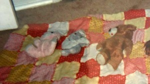Identifying a Vintage Bunny from Hallmark - stuffed toys on a quilt