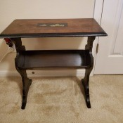 Value of an Antique Magazine Rack Side Table - rectangular table with shelf