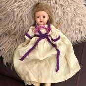 Information on an Old Home Industry Porcelain Doll - old doll on a furry rug