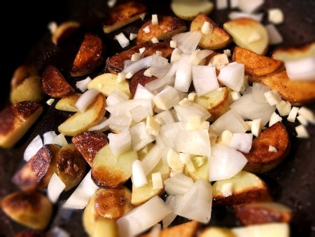 browned potatoes with onions in pan
