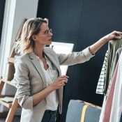 A woman selecting designer clothing.