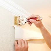 Applying wallpaper with glue.