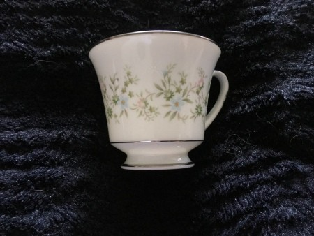 Value of Noritake China - white cup with silver edge and a pastel floral pattern