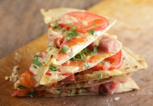 Thin pizza made from tortillas.