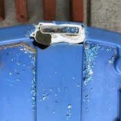 A plastic tub with a large hole chewed on the top.