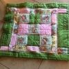 I Never Promised You a Rose Garden (Quilt) - finished quilt on a tile floor