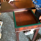 Value of a Vintage Table - table top folded in half exposing the box like interior of the table