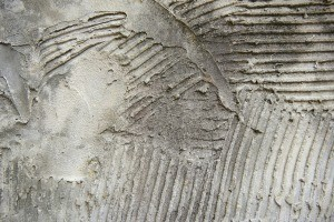 Dried tile adhesive on concrete.