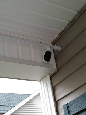 A security camera attached to a shower curtain rod.