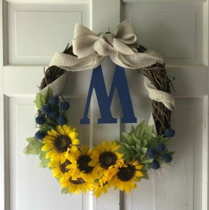 My First Wreath - grapevine wreath with sunflowers and a tan burlap ribbon bow