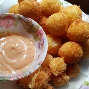 Cheese Filled Potato Ballson plate with sauce
