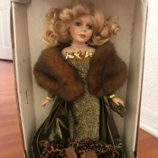 Value of a Collector's Choice Porcelain Doll - doll in box, wearing an evening gown and a fur stole