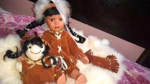 Value of a Palmary Collection Porcelain Doll - generic Native American doll