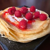 piled crepes with strawberries