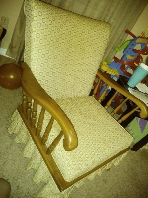 Value of a Conant Ball Chair - arm chair with upholstered back and seat with matching ruffled skirt around the bottom