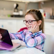 A girl using an iPad