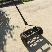 Value of a Craftsman Yard Man Reel Mower - old reel mower on driveway